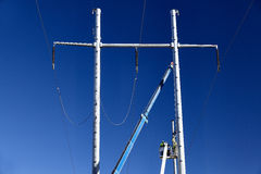 High voltage transmission line tower men Royalty Free Stock Photography