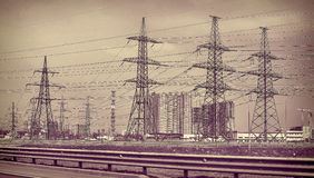 High-voltage transmission lines along the road Royalty Free Stock Photos