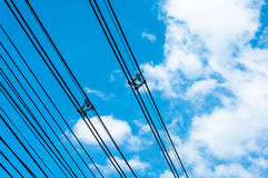High voltage transmission lines on blue sky Royalty Free Stock Images