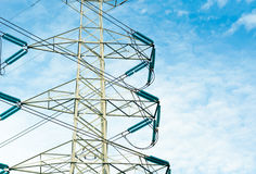 High voltage transmission lines isolated on blue sky background Stock Photography