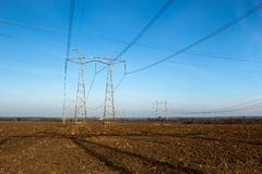 High voltage transmission lines and pylons Stock Photos