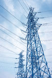 High voltage transmission pylon background Stock Photo