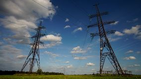 High voltage transmission pylon.High-voltage tower sky background stock video footage