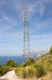 High-Voltage Transmission Tower. In the mountains stock photo