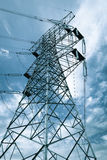 High-voltage transmission tower. Against a blue sky background stock photo