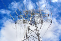 High voltage transmission tower. Against blue sky royalty free stock photography