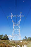 High voltage transmission tower. Against blue sky royalty free stock images