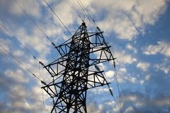 High voltage transmission tower at dusk. high-voltage transmission line in Russia. High-voltage transmission line in Russia stock photo