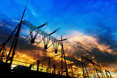 The high voltage transmission tower. Transmission tower in the sunset stock photography