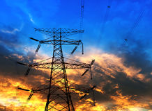 The high voltage transmission tower. In the sunset royalty free stock photography
