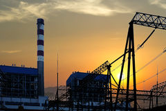 The high voltage transmission tower in the sunset Stock Photos