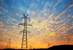 The high voltage transmission tower. In the sunset royalty free stock photo