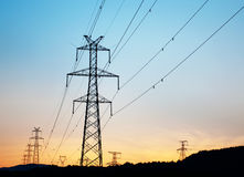The high voltage transmission tower. In the sunset royalty free stock images