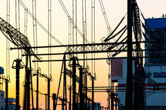 The high voltage transmission tower in the sunset Royalty Free Stock Photo