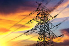 High voltage transmission tower. High voltage transmission tower at twilight time Stock Photo