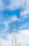 High voltage transmission tower in the wild. High voltage cable tower metal stent enormous support Stock Image