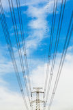 High voltage transmission tower in the wild. High voltage cable tower metal stent enormous support Stock Photo