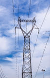 High voltage transmission tower in the wild. High voltage cable tower metal stent enormous support Stock Photos