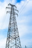 High voltage transmission tower in the wild. High voltage cable tower metal stent enormous support Royalty Free Stock Photos