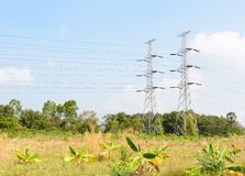 High voltage transmission towers in field Royalty Free Stock Photography