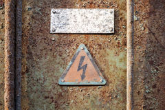 High voltage triangle sign on grunge wall Stock Photos