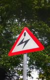 High voltage warning sign UK. High voltage overhead cable warning sign Stock Photography