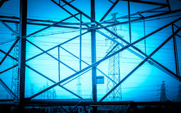 The high-voltage wire tower. The tower frame transmission line open field erected Stock Photos