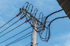 High-voltage wires. On a light pole Royalty Free Stock Photo