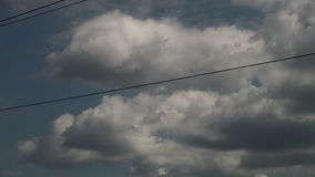 High-voltage wires on the mast sky with clouds stock video footage