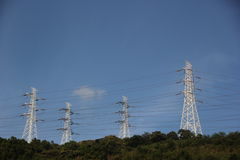 The high voltage wires on the top of the hill Royalty Free Stock Images