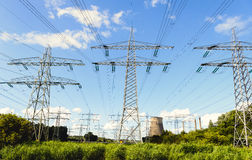 High voltages lines and power pylons in a rural area Royalty Free Stock Photo