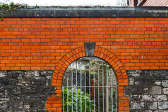 High wall and lattice gate Royalty Free Stock Photos