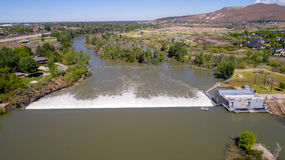 High water in the Boise River Idaho and Dam. Diversion Dam on the Boise River in Idaho Spring stock photos