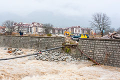High water flow in Glazne river after heavy rains and remains of bridge carried away by the waters. Bansko, Bulgaria - November 9, 2016: High water flow in royalty free stock photography