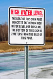 High water level sign along a storm drainage pond Stock Photos