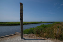 High water mark column at Vidaa, Wadden Sea, Denmark Stock Images