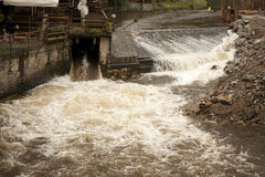 High water on river sluice Stock Images
