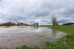 High water of a small river on the fields in spring royalty free stock photography