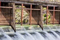 High water spills through gates on a Dam Stock Photos