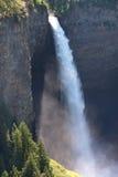 High Waterfall. A large waterfall falls down among steel cliffs. Helmcken Falls, Wells Gray Park, Canada Stock Photo