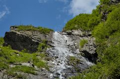 High waterfall in Carpathians mountains under blue sky. Royalty Free Stock Image