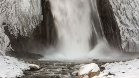 High waterfall Emir in the tract Gil-Su high in the Caucasus mountains in winter. stock footage