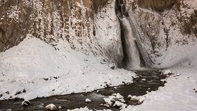 High waterfall Emir in the tract Gil-Su high in the Caucasus mountains in winter. stock video
