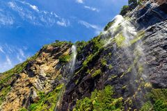 High waterfalls in Milford Sound, New Zealand royalty free stock image
