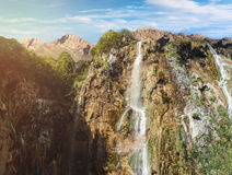 High waterfalls in the mountains. Springtime royalty free stock photos