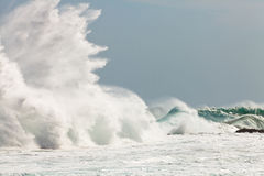 High wave breaking on the rocks Stock Image