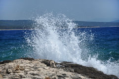 High wave breaking on the rocks of the coastline Stock Image
