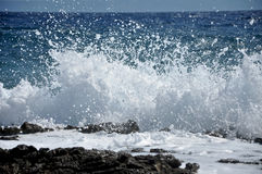 High wave breaking on the rocks of the coastline Stock Photo