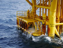 High wave hitting the Boat Landing and Producing Slots. At Offshore Platform during bad weather conditions (high wave) - Oil and Gas Industry Royalty Free Stock Photos
