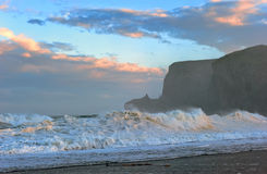 High waves on the beach after a storm. Stock Photos